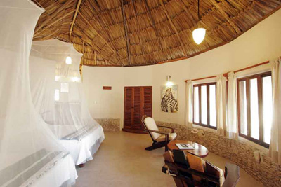 beautifully decorated room with thatched roof