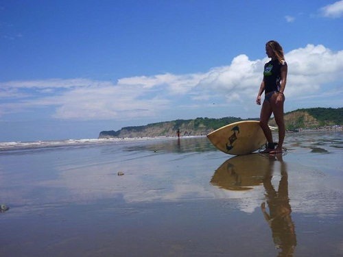 women with a surfing board