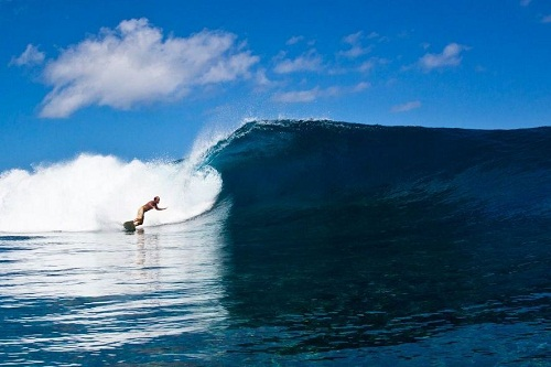 A Surfer playing with the wave