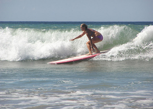 Woman is surfing