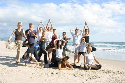 Yoga on the beach for male and female
