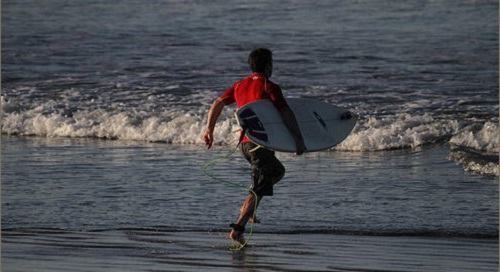 A surfer with surfing board